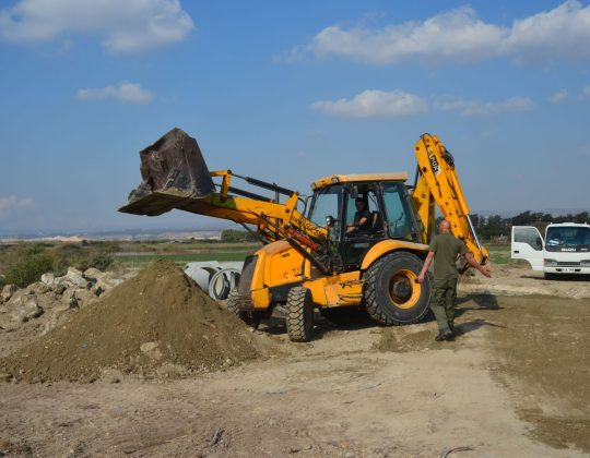 A farmer caught illegally uprooting a road to channel run-off into Akrotiri Lake in 2016